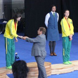 Alfred C Weir shakes hand with athlete