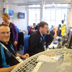 NVT Players working at the Commonwealth Games Service Desk