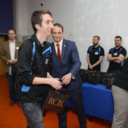 David Grevemberg presents a sports watch gift from NVT Group to one of the NVT Players