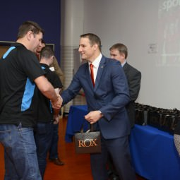 David Grevemberg shakes hands with one of the NVT Players