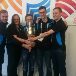 NVT Group team photo with the Queen's Baton