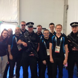 NVT team photo with security at the Commonwealth Games