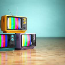 38068661 - vintage television concept. stack of retro tv set on green background. 3d