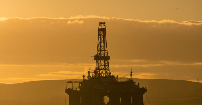 65943969 - stacked semi submersible oil rig at cromarty firth in invergordon, scotland, uk? many offshore drilling rig parked and waiting for drilling work offshore north sea